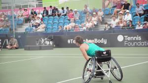 Lauren Jones playing a match at a wheelchair tennis tournament