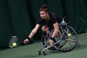 Lauren Jones - women's wheelchair tennis player hitting a shot